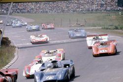 Fred Baker, #29 McLaren M6B-Chevrolet, leads Jo Siffert, #2 Porsche 908 Spyder, John Cordts, #55 McL