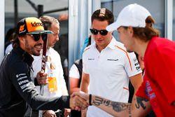 Fernando Alonso, McLaren, and Stoffel Vandoorne, McLaren, meet players from the Montreal Canadiens N