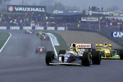 Damon Hill, Williams FW15C, leads Michael Schumacher, Benetton B193