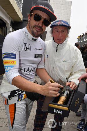 Fernando Alonso, McLaren signs a champagne bottle for Jackie Stewart (GBR)