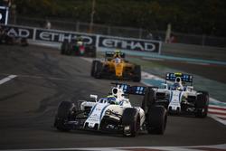 Felipe Massa, Williams FW38, leads Valtteri Bottas, Williams FW38, and Jolyon Palmer, Renault RE16