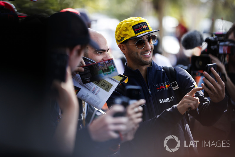 Daniel Ricciardo, Red Bull Racing, takes a picture for fans