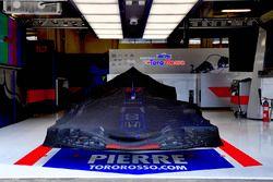 Scuderia Toro Rosso STR13 under covers in the garage
