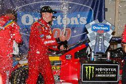 Kyle Busch, Joe Gibbs Racing, Toyota Camry Skittles Red White & Blue celebrates in victory lane