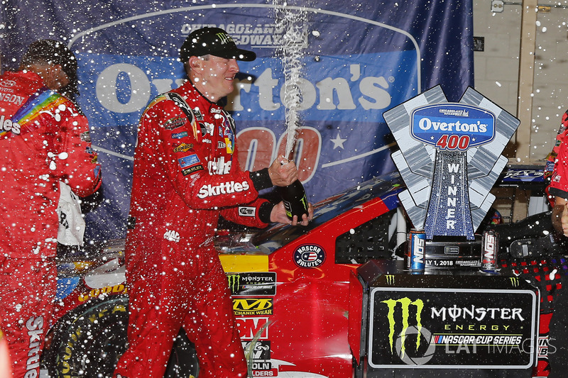 Kyle Busch, Joe Gibbs Racing, Toyota Camry Skittles Red White & Blue celebrates in victory lane
