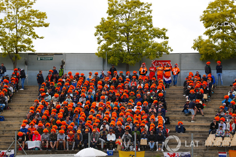 Dutch fans of Max Verstappen, Red Bull Racing RB14, wear orange wigs