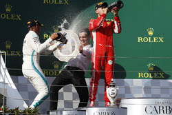 Lewis Hamilton, Mercedes-AMG F1 and Sebastian Vettel, Ferrari celebrate with the champagne on the podium