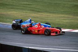 Alex Wurz, Benetton Playlife B198 attempts to overtake Eddie Irvine, Ferrari F300