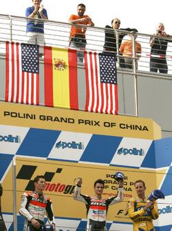 Podio: segundo puesto Nicky Hayden, Repsol Honda Team, ganador de la carrera Dani Pedrosa, Repsol Honda Team, tercer puesto Colin Edwards