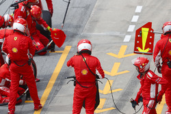 Ferrari mechanics wait for Kimi Raikkonen, Ferrari SF71H, to make a pit stop