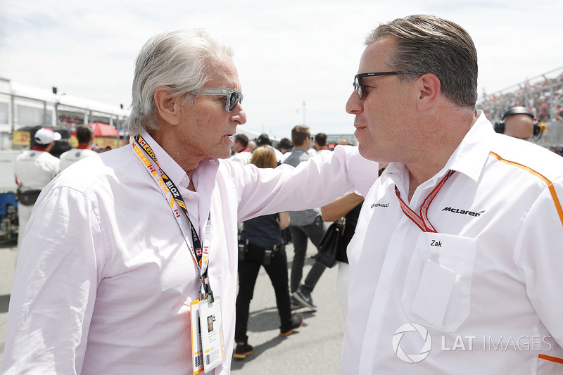Actor Michael Douglas with Zak Brown, Executive Director, McLaren Technology Group, on the grid