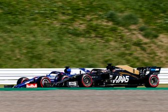 Romain Grosjean, Haas F1 Team VF-19 and Daniil Kvyat, Toro Rosso STR14