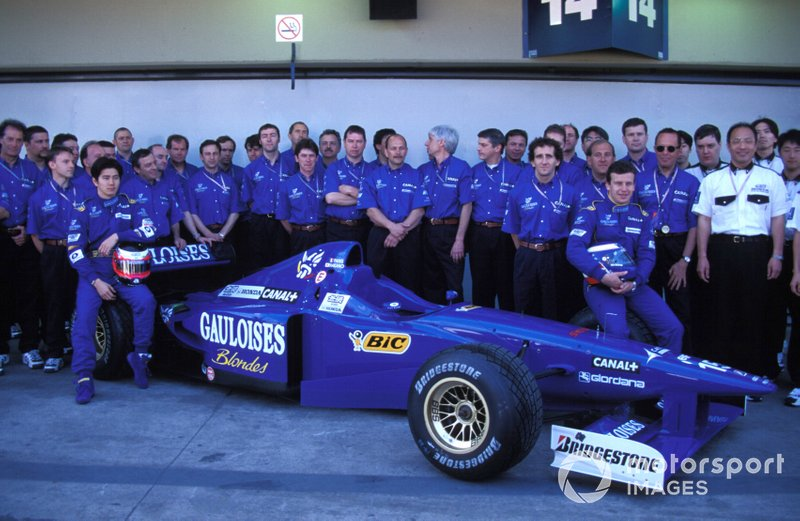 Prost team photo, with Olivier Panis and Shinji Nakano sat on a Prost JS45 Mugen-Honda
