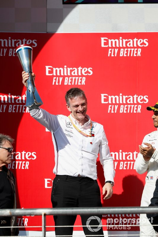 James Allison, Technical Director, Mercedes AMG, celebrates with the Constructors trophy on the podium