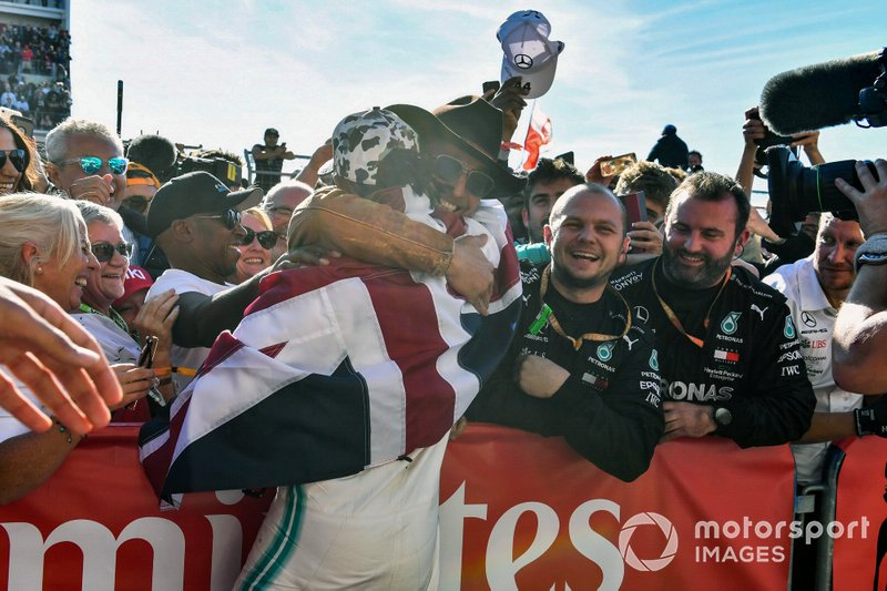 Lewis Hamilton, Mercedes AMG F1, 2nd position, celebrates with actor and friend Matthew McConnaughtey after securing his sixth drivers world championship title