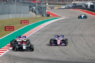 Antonio Giovinazzi, Alfa Romeo Racing C38, leads Lance Stroll, Racing Point RP19, and Sergio Perez, Racing Point RP19