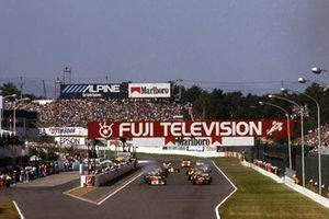 Ayrton Senna, McLaren MP4/5B ve Alain Prost, Ferrari 641/2 lead startta