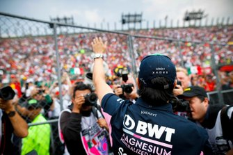 Sergio Perez, Racing Point, waves to his home fans in the drivers parade