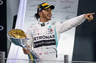 Lewis Hamilton, Mercedes AMG F1, 1st position, leaves the podium with his trophy