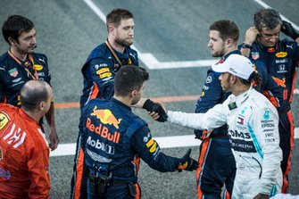 Lewis Hamilton, Mercedes AMG F1, 1st position, shakes hands with Red Bull mechanics at the end of the race