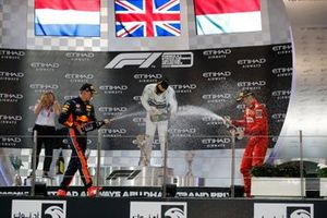 Max Verstappen, Red Bull Racing, 2nd position, Lewis Hamilton, Mercedes AMG F1, 1st position, and Charles Leclerc, Ferrari, 3rd position, celebrate on the podium with Champagne
