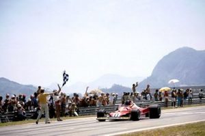 Carlos Reutemann, Ferrari 312T2 takes the chequered flag to secure his first race win with Ferrari and claim the first victory for tyre manufacturer Michelin