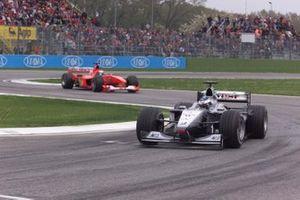 Mika Hakkinen,McLaren MP4/15 Mercedes leads Michael Schumacher, Ferrari F1 2000
