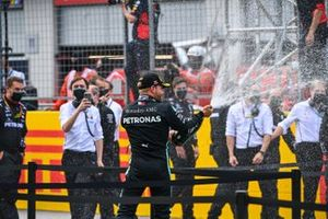 Valtteri Bottas, Mercedes-AMG Petronas F1, sprays champage on the podium