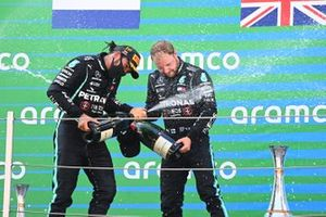 Lewis Hamilton, Mercedes-AMG Petronas F1, 1st position, Valtteri Bottas, Mercedes-AMG Petronas F1, 3rd position, celebrate on the podium with Champagne