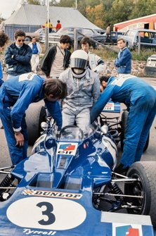 Jackie Stewart climbs into his Tyrrell 001 Ford