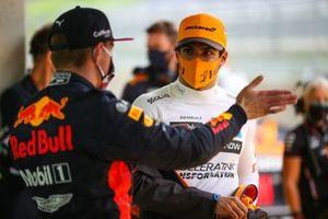 Max Verstappen, Red Bull Racing, talks to Carlos Sainz Jr., McLaren