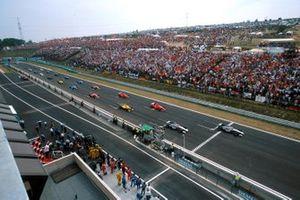 Mika Hakkinen, McLaren MP4-13 leads the start of the race