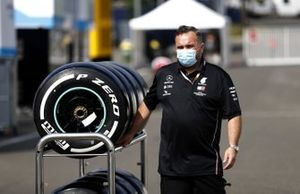 A member of the Mercedes team with their Pirelli tyres
