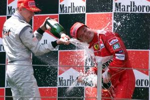 Race winner Mika Hakkinen, McLaren and Rubens Barrichello, Ferrari on the podium