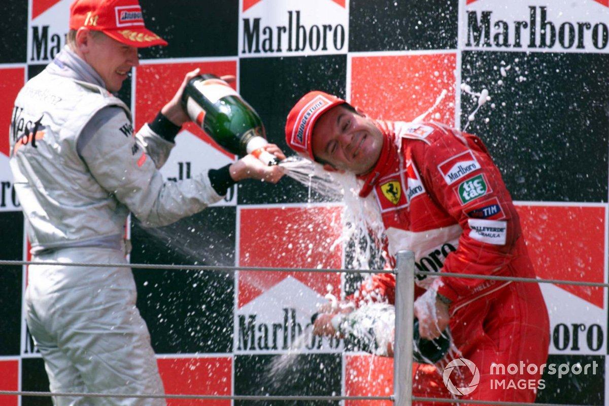 Race winner Mika Hakkinen, McLaren and Rubens Barrichello, Ferrari on the podium