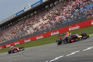 Daniel Ricciardo, Red Bull Racing RB10 Renault, leads Fernando Alonso, Ferrari F14T