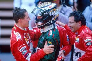 Eddie Irvine, Jaguar R3 celebrates his third position with race winner Michael Schumacher, Ferrari F2001