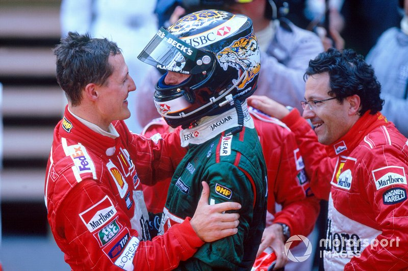 Eddie Irvine, Jaguar R3, celebra pódio com vencedor Michael Schumacher, Ferrari F2001