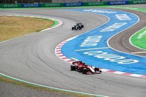 Charles Leclerc, Ferrari SF1000, leads Valtteri Bottas, Mercedes F1 W11 EQ Performance