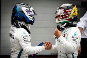 Valtteri Bottas, Mercedes AMG F1, congratulates team mate Lewis Hamilton, Mercedes AMG F1, on securing pole