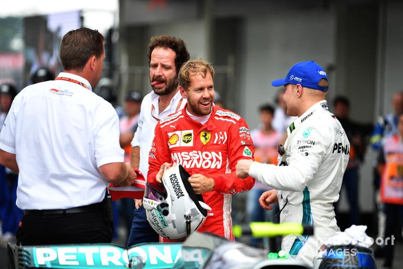 Sebastian Vettel, Ferrari and Valtteri Bottas, Mercedes AMG F1 in Parc Ferme