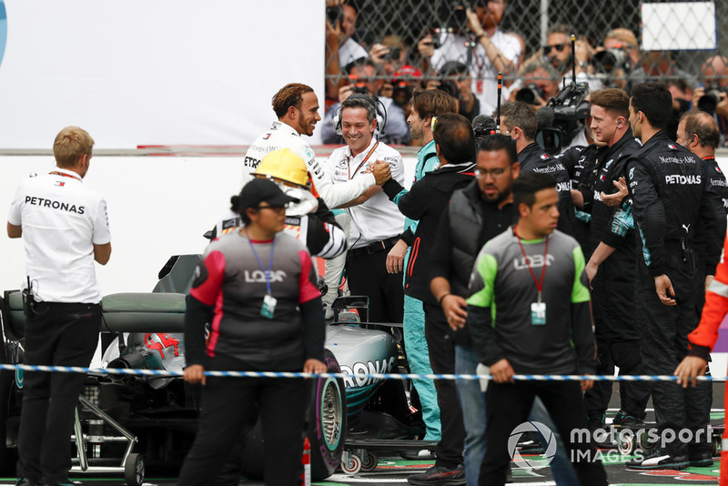 Lewis Hamilton, Mercedes AMG F1, celebrates with his team after securing his 5th world drivers championship