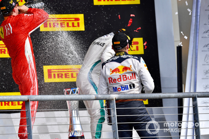 (L to R): Kimi Raikkonen, Ferrari, Lewis Hamilton, Mercedes AMG F1 and Max Verstappen, Red Bull Racing celebrate with the champagne on the podium