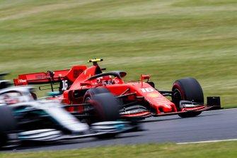 Charles Leclerc, Ferrari SF90, passes Lewis Hamilton, Mercedes AMG F1 W10