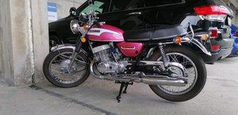 Мотоцикл Suzuki Себастьяна Феттеля в паддоке трассы