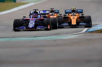 Daniil Kvyat, Toro Rosso STR14, leads Lando Norris, McLaren MCL34, and Carlos Sainz Jr., McLaren MCL34