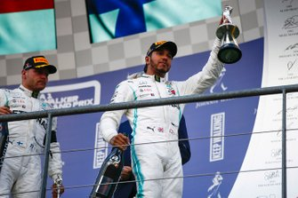 Lewis Hamilton, Mercedes AMG F1, 2nd position, and Valtteri Bottas, Mercedes AMG F1, 3rd position, leave the podium