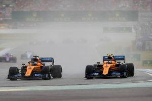 Carlos Sainz Jr., McLaren MCL34, battles with Lando Norris, McLaren MCL34