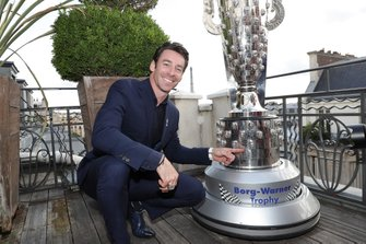 Simon Pagenaud with Borg-Warner Trophy in Paris