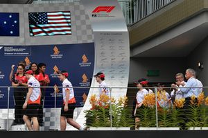 Ross Brawn, Formula One Managing Director of Motorsports and Chase Carey, Chief Executive Officer and Executive Chairman of the Formula One Group on the podium with F1 in Schools